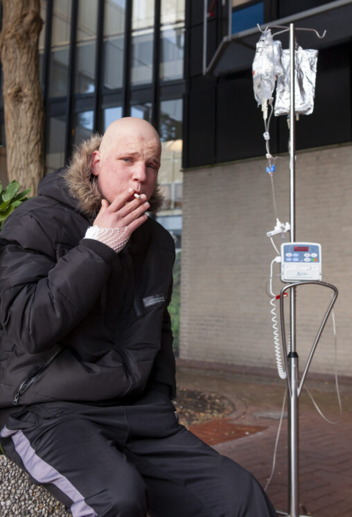 Smokers outside the hospital doors 2